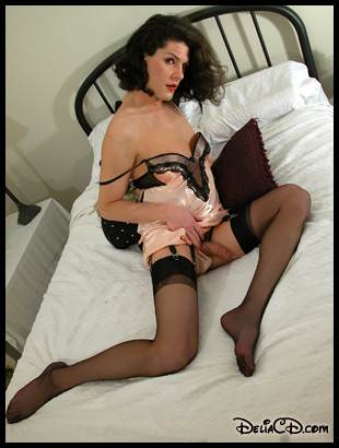Pin-up Delia in black garter belt & stockings